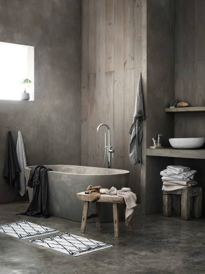 Exotic Wabi Sabi Interior Design Style: Beautiful Minimalism. Wooden trimmed bathroom with stone tub