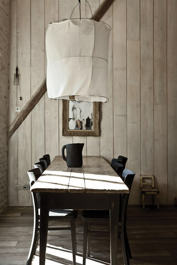 Exotic Wabi Sabi Interior Design Style: Beautiful Minimalism. Black and white colored dining room with wooden trimming