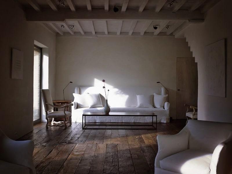 Minimalistic bedroom design with natural wooden floor