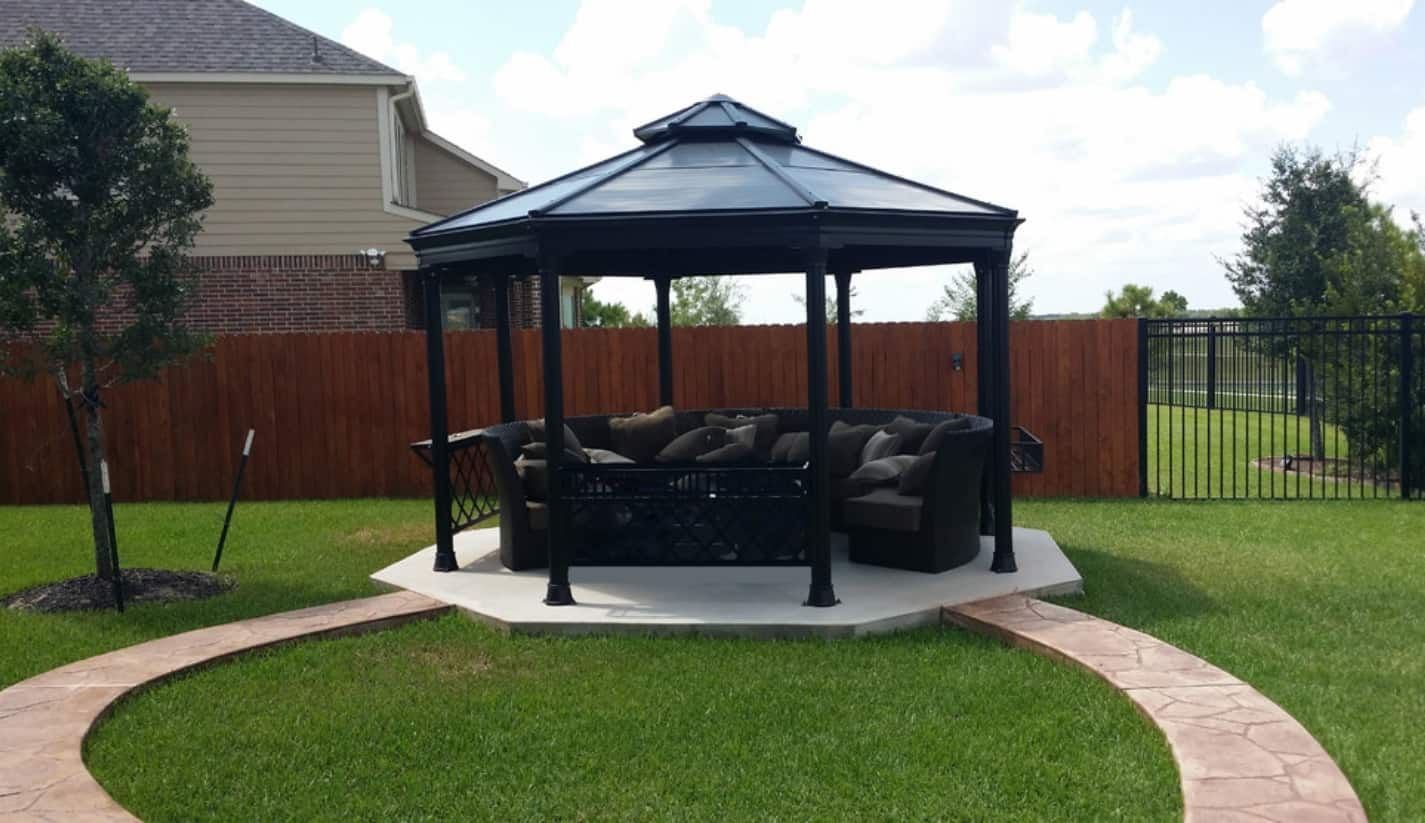Top Reasons Why You Should Cover Your Patio or Deck. Black covered round gazebo in the yard