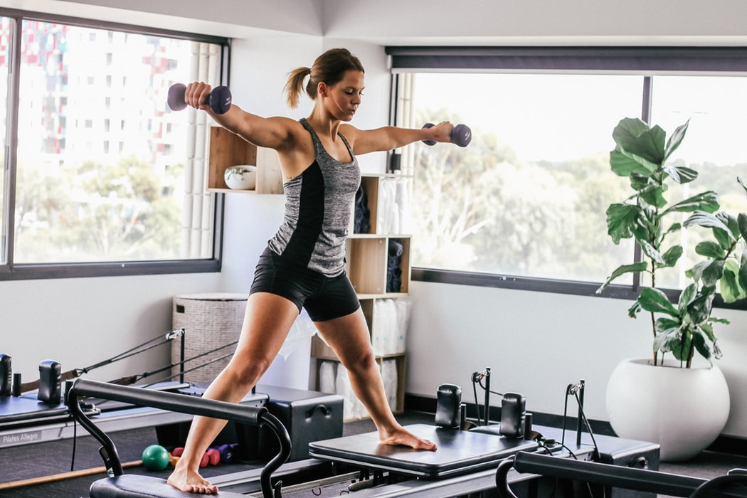 How to Build the Perfect Home Gym. The working out at a small equipped room