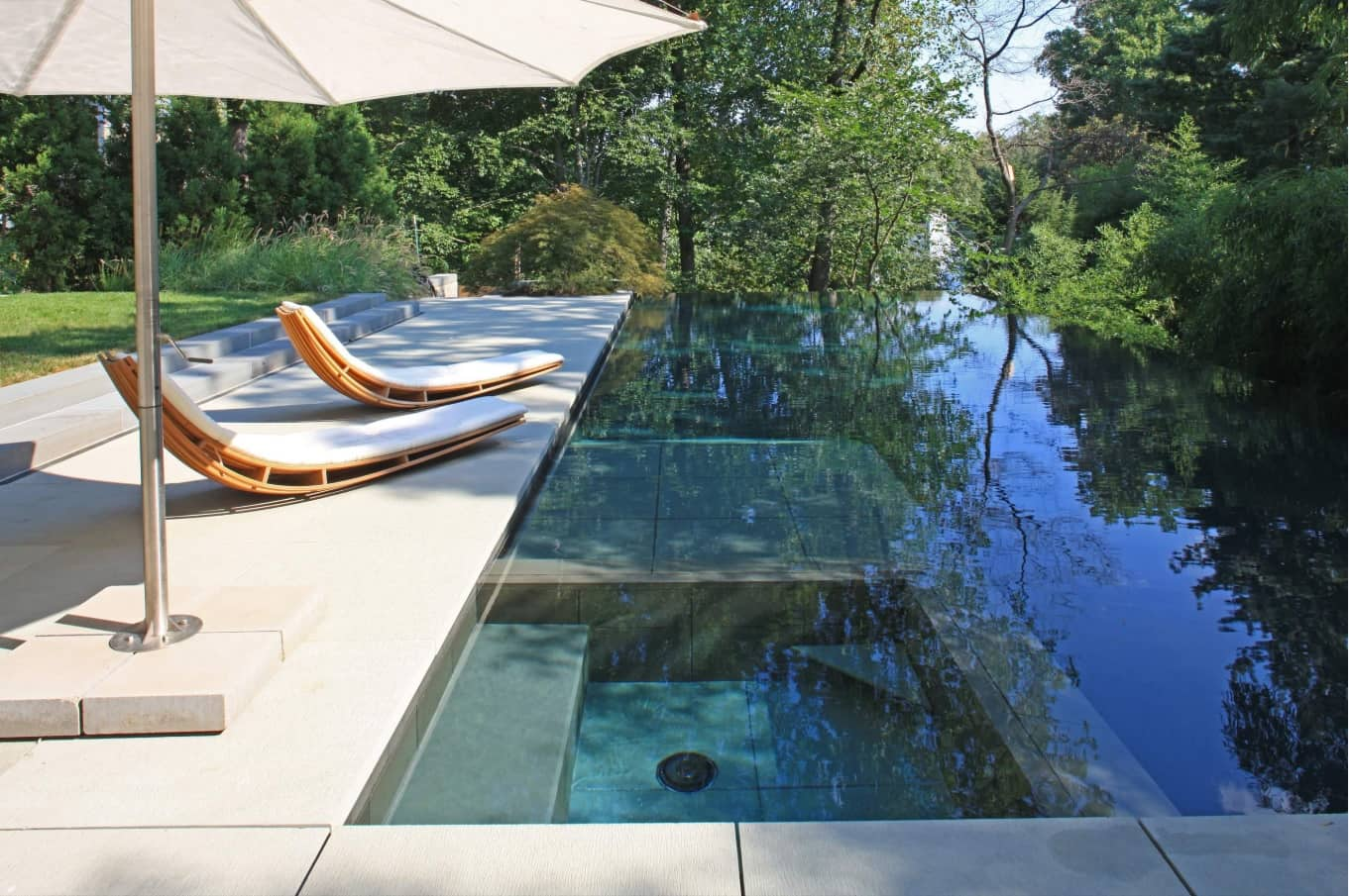 How To Maintain Your Pool Effectively. Great designed summer endless pool with crystal clean water
