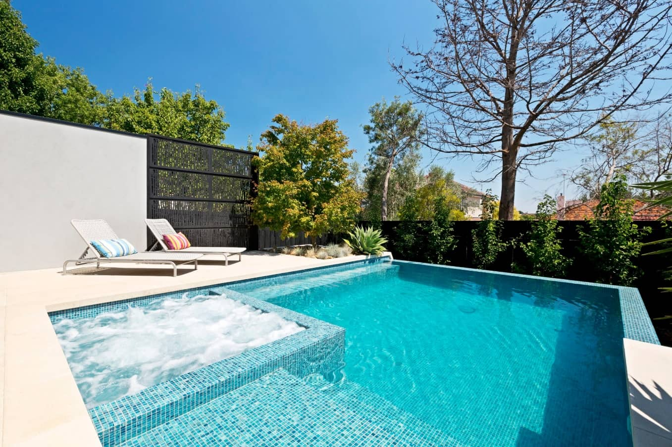 How To Maintain Your Pool Effectively. Great modern backyard design with the sunbathe zone and jacuzzi in the pool