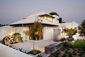 5 Significant Reasons For Maintaining Your Roof Regularly. White modern house with hip and valley roof type and neat concreted yard