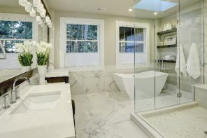 7 Genius tips to deep clean a bathroom. Great bathroom interior design in light marble color and boundless glass shower cabin