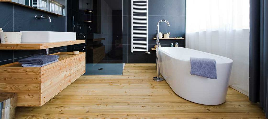 Pros and Cons of Installing Laminate Flooring in Bathroom. Great light wood for Scandinavian designed room with darkened glass of the shower