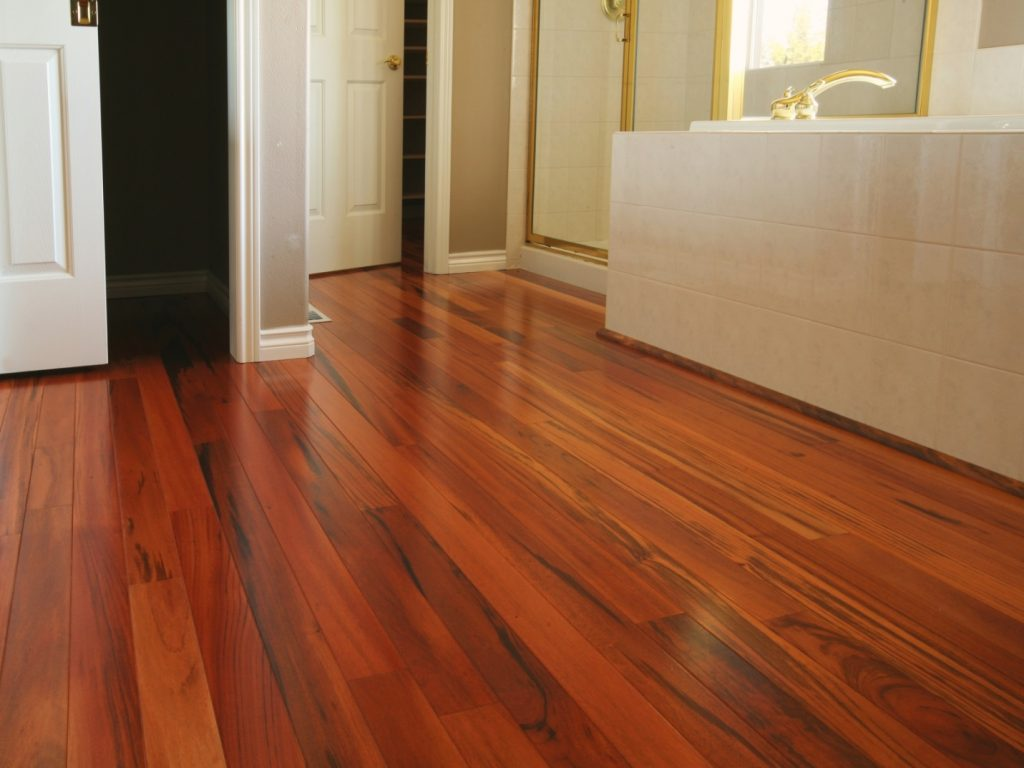 Pros and Cons of Installing Laminate Flooring in Bathroom. Noble oak timber imitating floor material