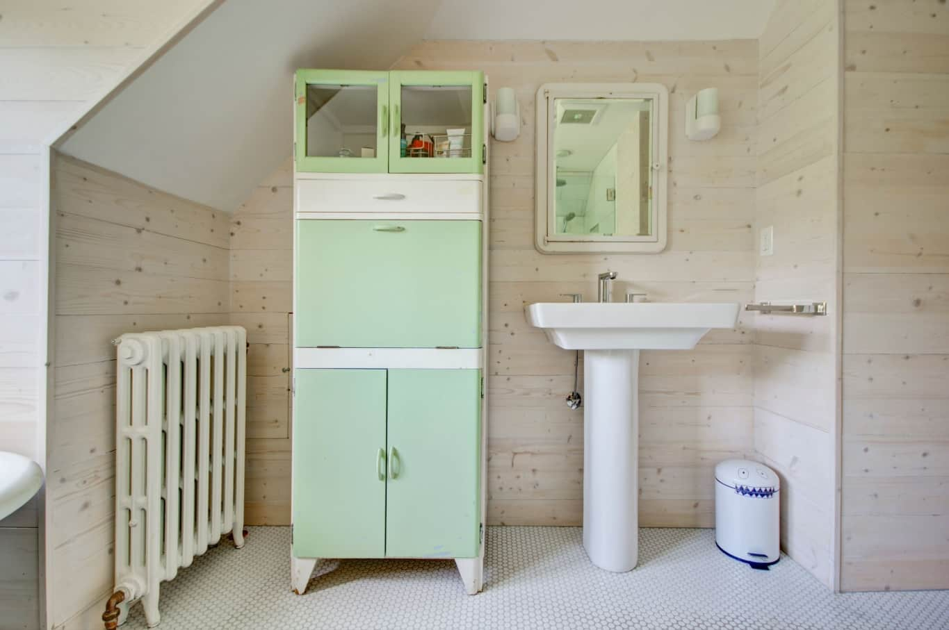 9 Great Bathroom Design Trend for 2020 and Beyond. Mint cabinet and wooden trimming for retro space