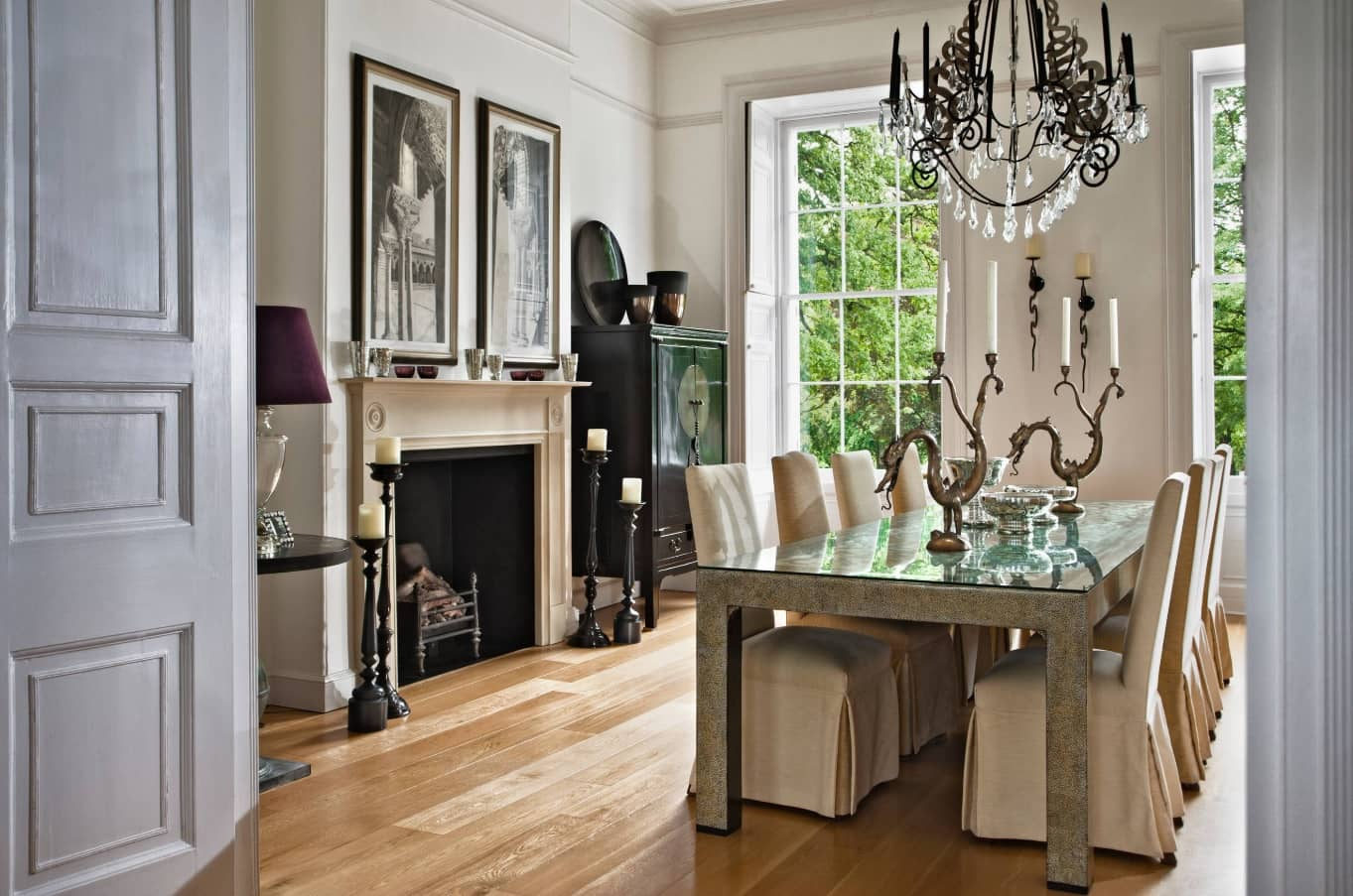 Quick Review of Types and Styles of Chandeliers. English classic interior with the sash window and restrained white colored walls