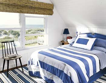 Marine styled bedroom with sloped ceiling