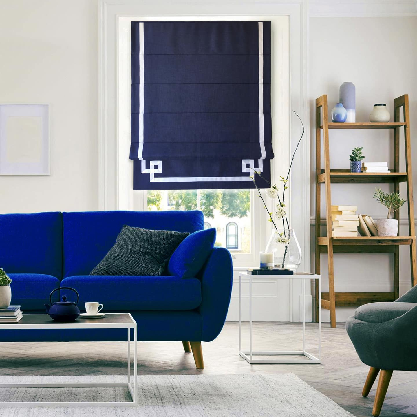 Window Treatments Trends: What's In and Out of Style? Blue colored curtains and sofa for interior accent