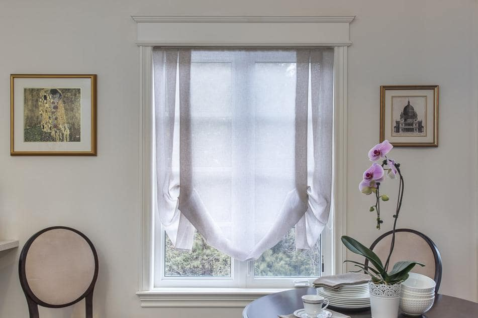 Window Treatments Trends: What's In and Out of Style? Tulle curtain for the casual interior of the room