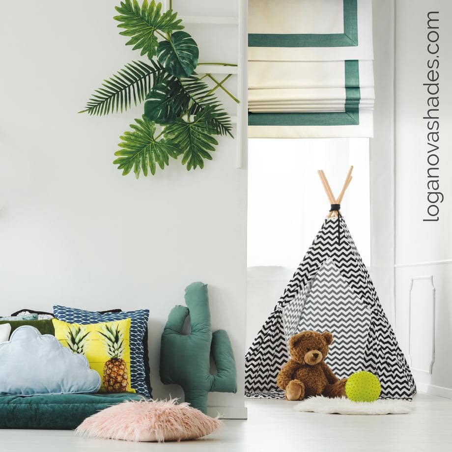 Window Treatments Trends: What's In and Out of Style? Green designed border of shades and green artificial plant for kids' room