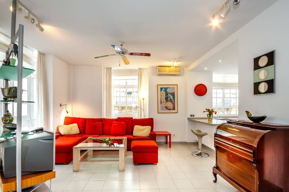 Red Living Room: Elegant & Bright Interior Design. Cozy white living with complex lighting and red furniture at the chatting zone