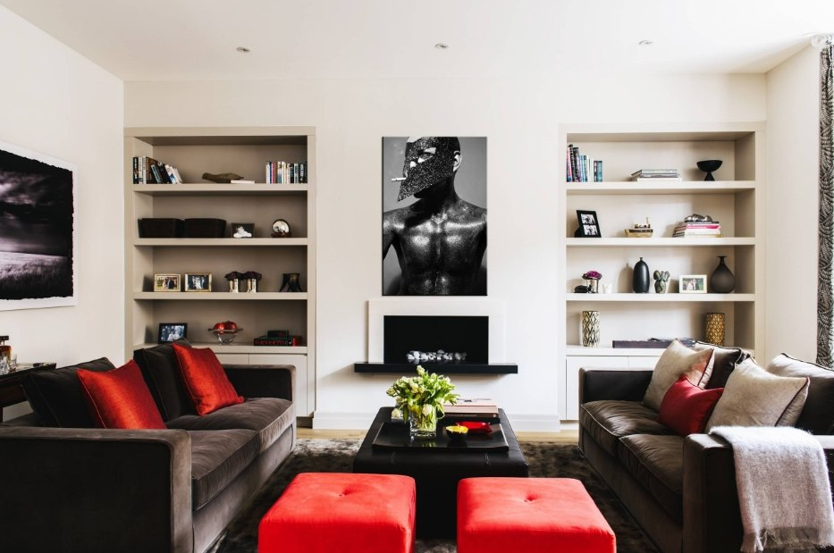 Red Living Room: Elegant & Bright Interior Design. White colored walls, open shelves and red pouffs for dark furnished sitting room
