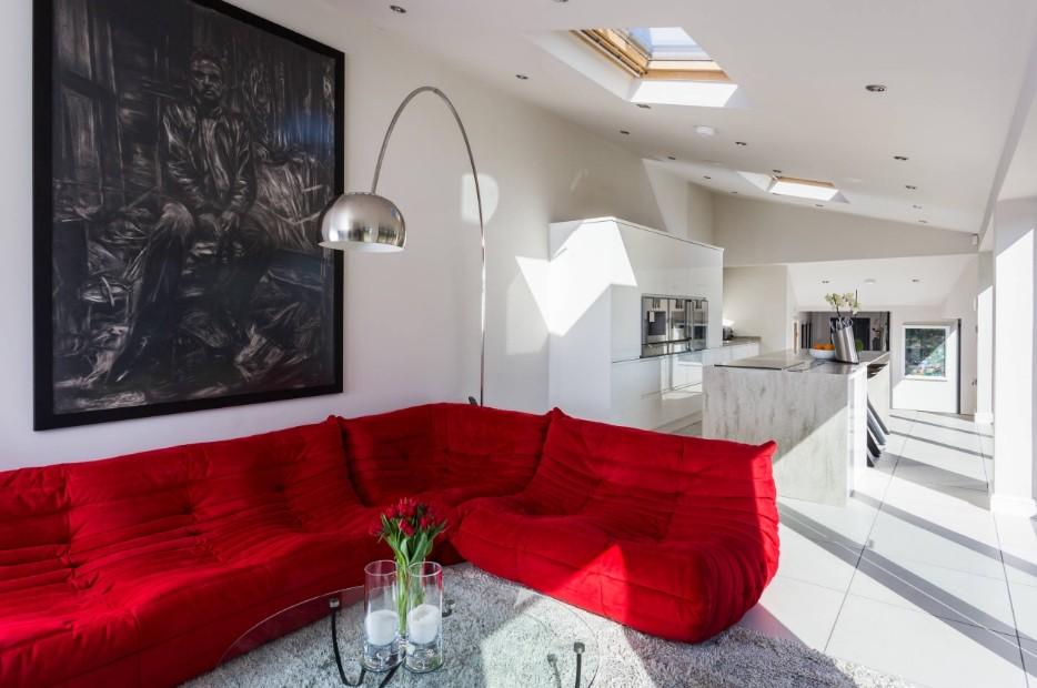 Red Living Room: Elegant & Bright Interior Design. Large silver floor lamp over the birght corner sofa