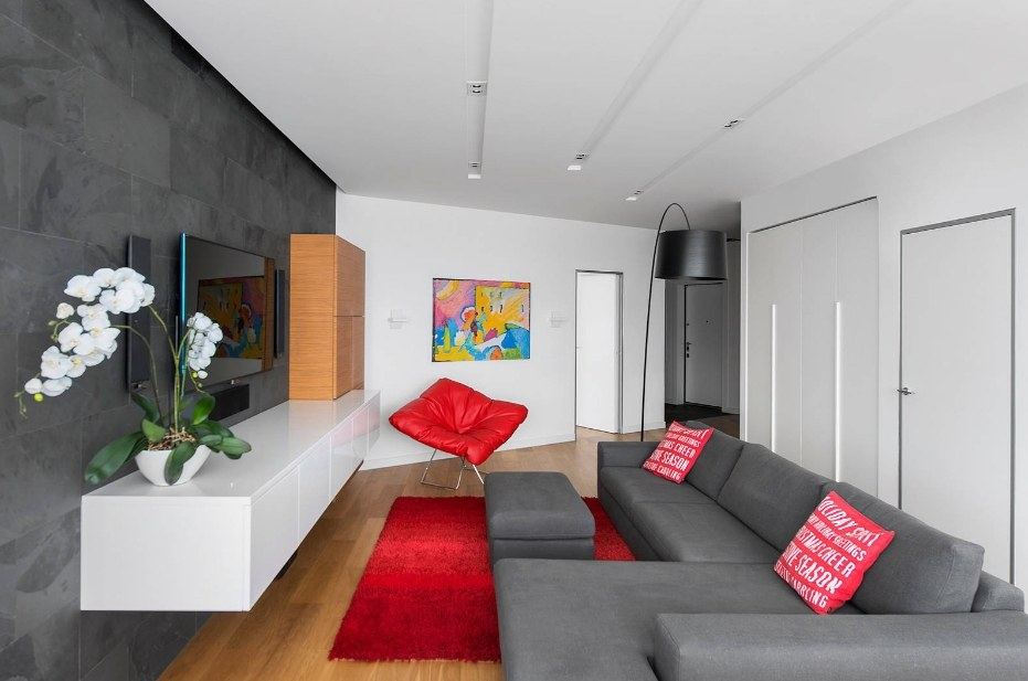 White living room with gray furniture set and slight red accents