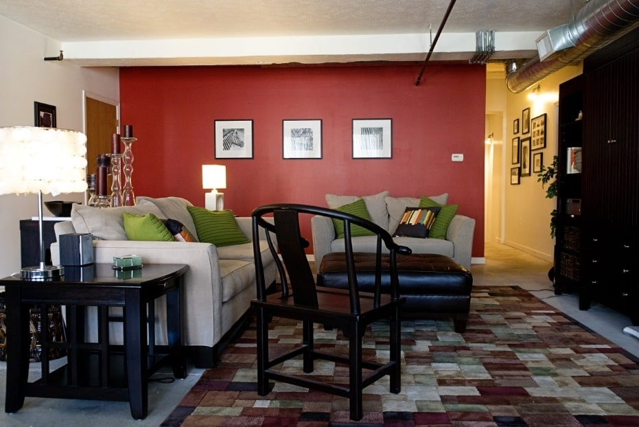 Red Living Room: Elegant & Bright Interior Design. Burgundy wall to emphasize pictures