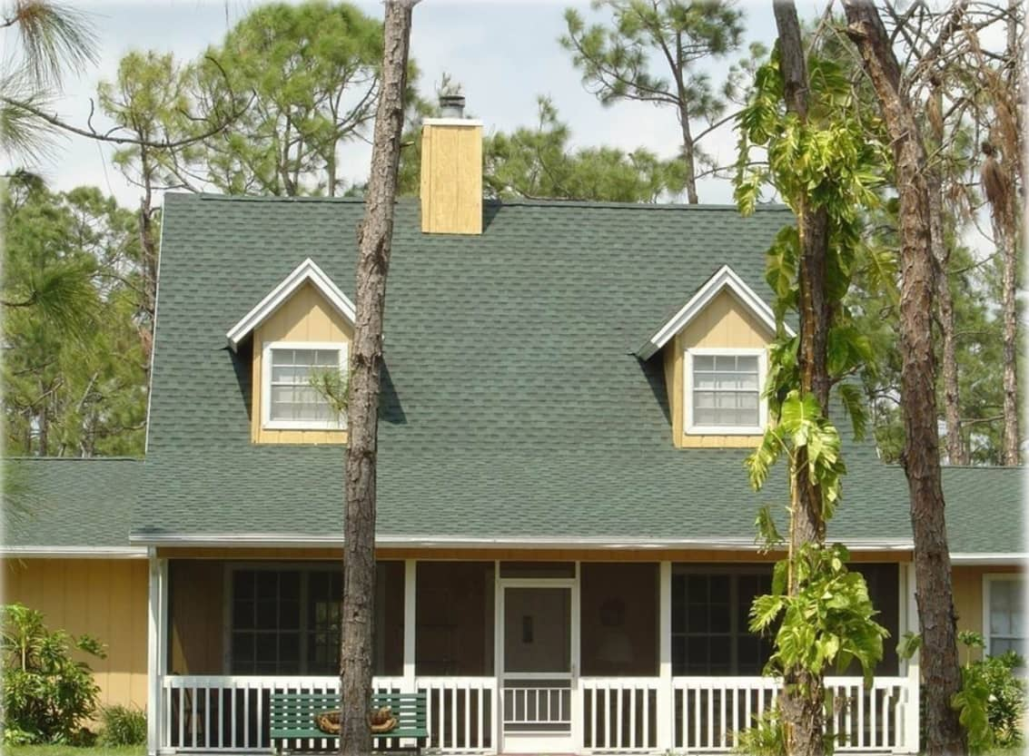 Types of Roofing Materials Overview. Asphalt Shingles green roof of the traditional American house