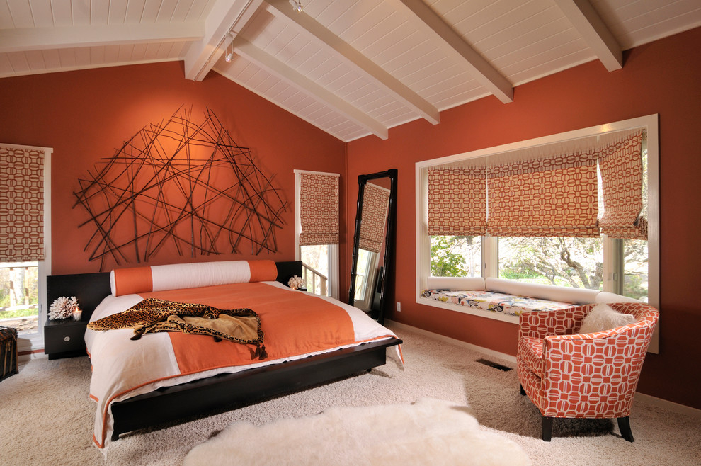 A bedroom dominated by warm shades of carrot orange and burnt clay
