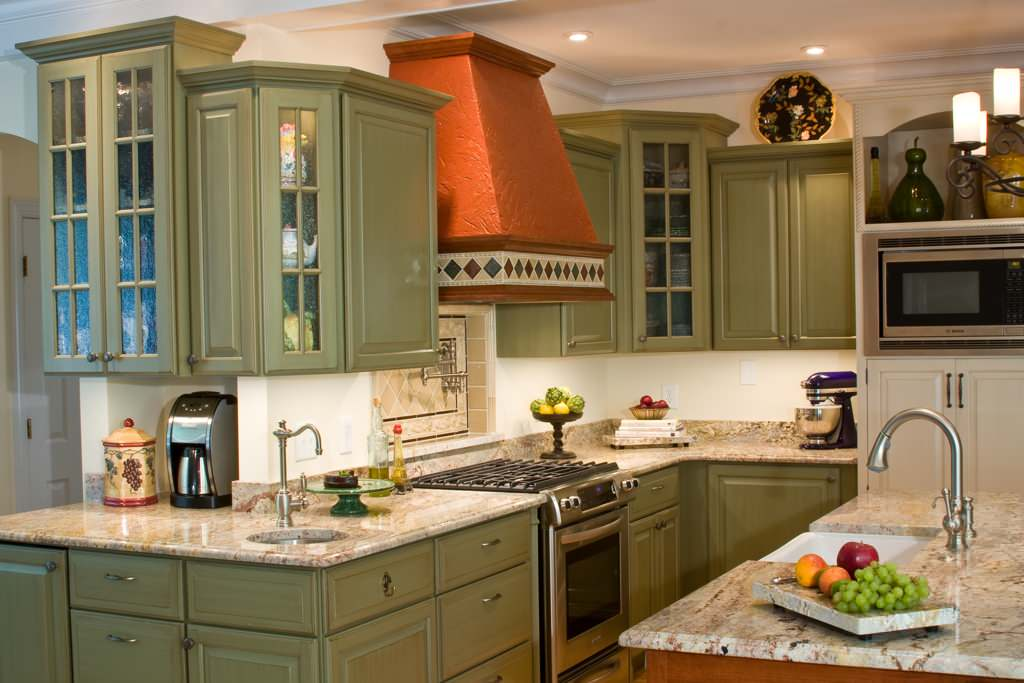 Clay-colored hood in a classic green kitchen