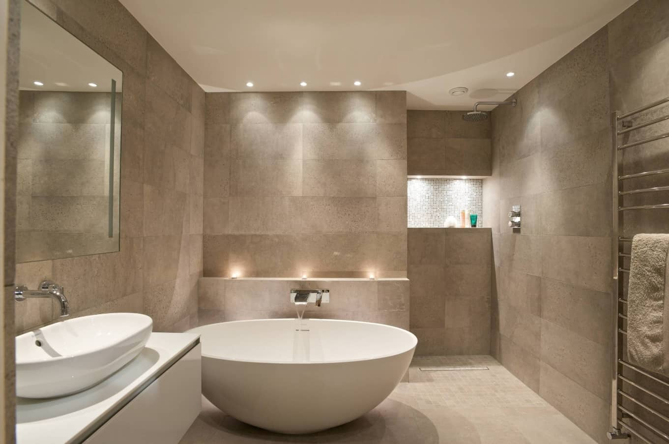 Ideas to Transform Your Apartment's Bathroom. Great design on gray with complex wall geometry and lighting