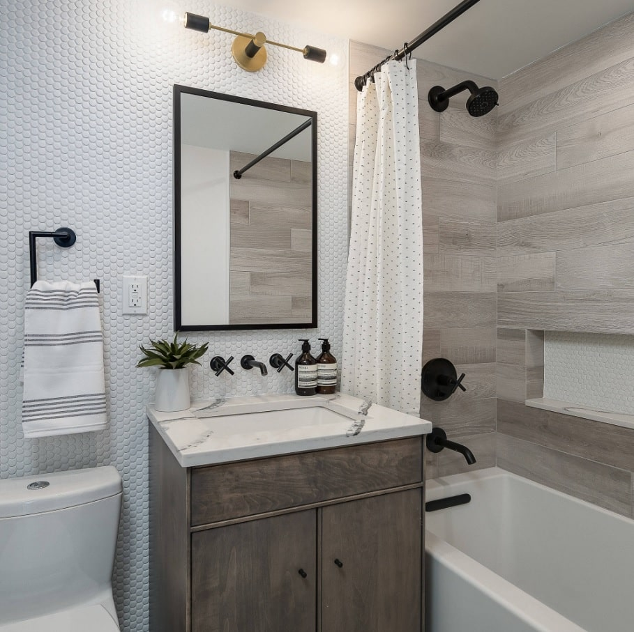 Ideas to Transform Your Apartment's Bathroom. Modern designed space with white and noble oak gray tones