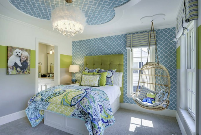 Dotted blue walls and platform bed