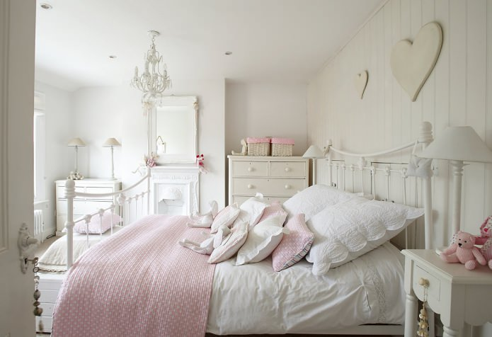 Shabby chic room for girl with creamy white matte walls and pink decorative elements