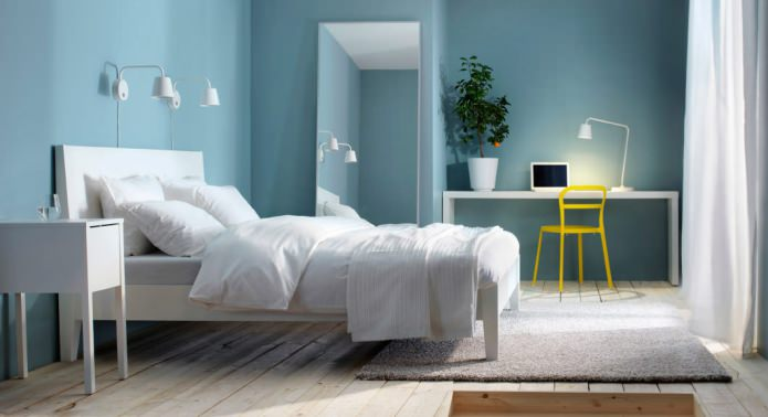 Unusual deep blue walls and simple interior design of the room for teenage girl