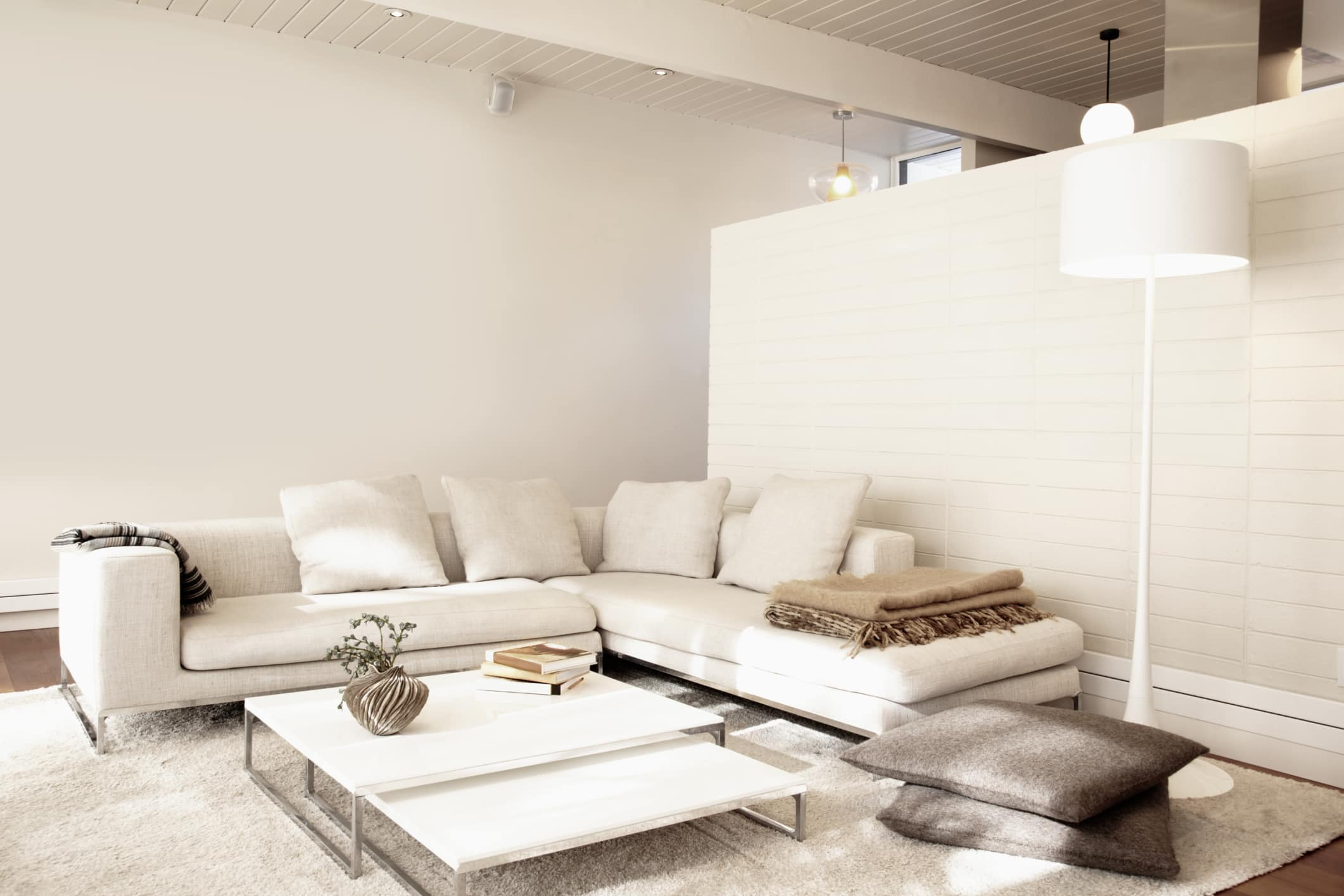 Feng Shui Interior Design and Decoration Philosophy. Ascetic living room with great corner sofa and low coffee table
