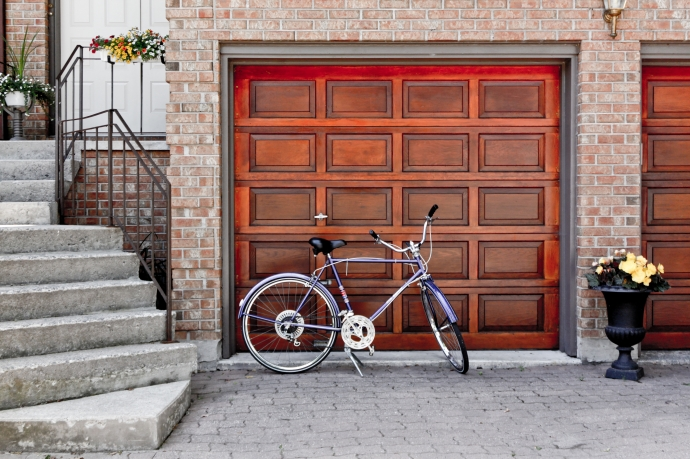 Building a Garage From the Ground-up: Step by Step Guide. The classic wooden garage door with the bicycle at the front