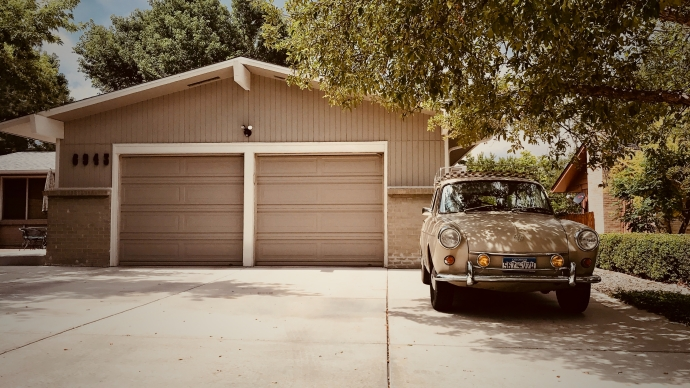 Building a Garage From the Ground-up: Step by Step Guide. Simple designed garage in beige color