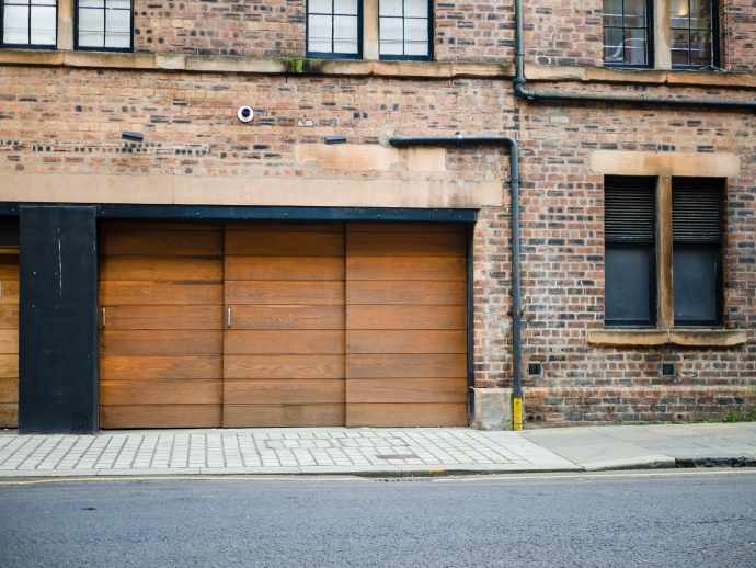 Building a Garage From the Ground-up: Step by Step Guide. Wooden trimmed sectional garage doors