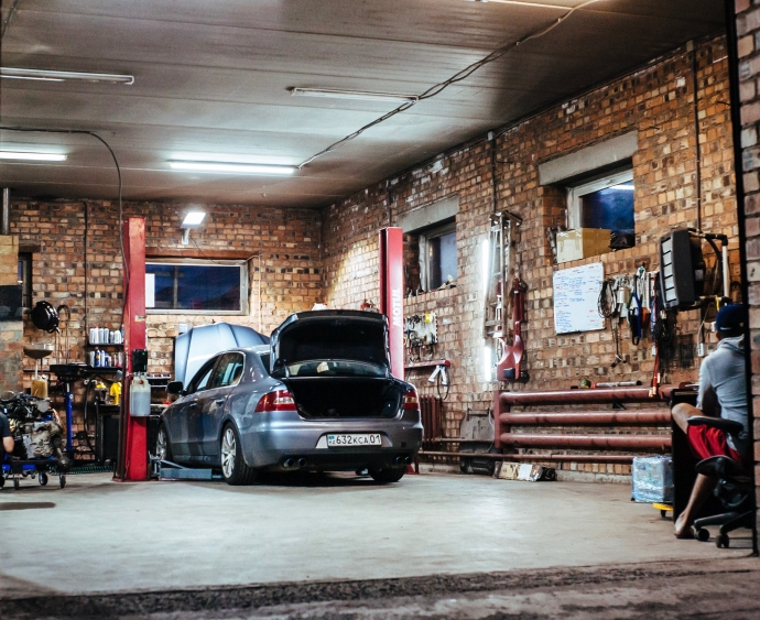 Building a Garage From the Ground-up: Step by Step Guide. Home garage inside with the car