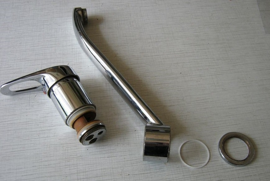 The faucet is fully disassembled