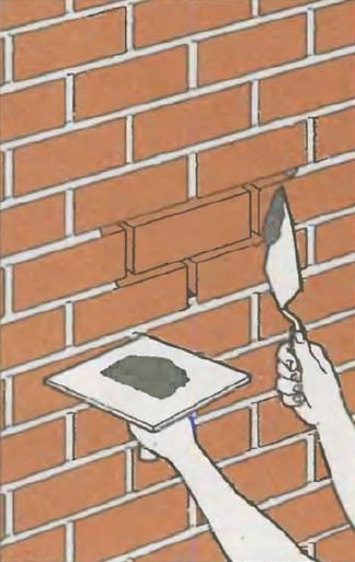 Masonry Pointing: Joints Recovery to Spalling Brick Repair. Seam recovery with mason's trowel