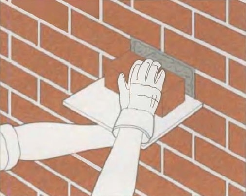 Masonry Pointing: Joints Recovery to Spalling Brick Repair. Inserting a new brick into the free slot
