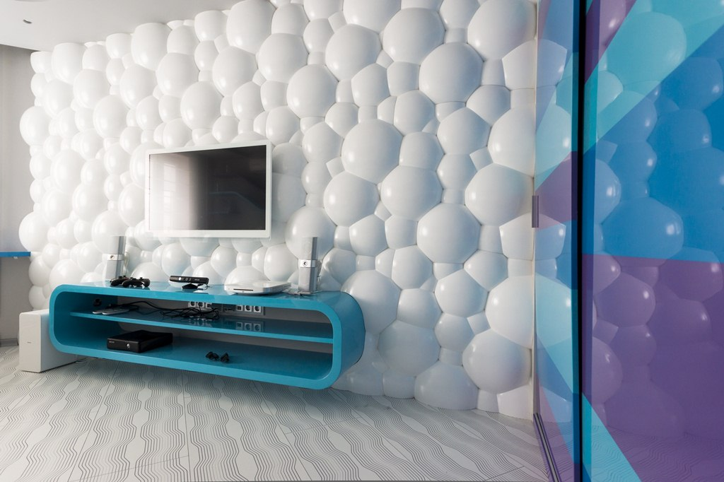 3D Textured Gypsum Wall Panels to Make Accent. Bubble panels and turquoise futuristic shelf in amazingly advanced interior