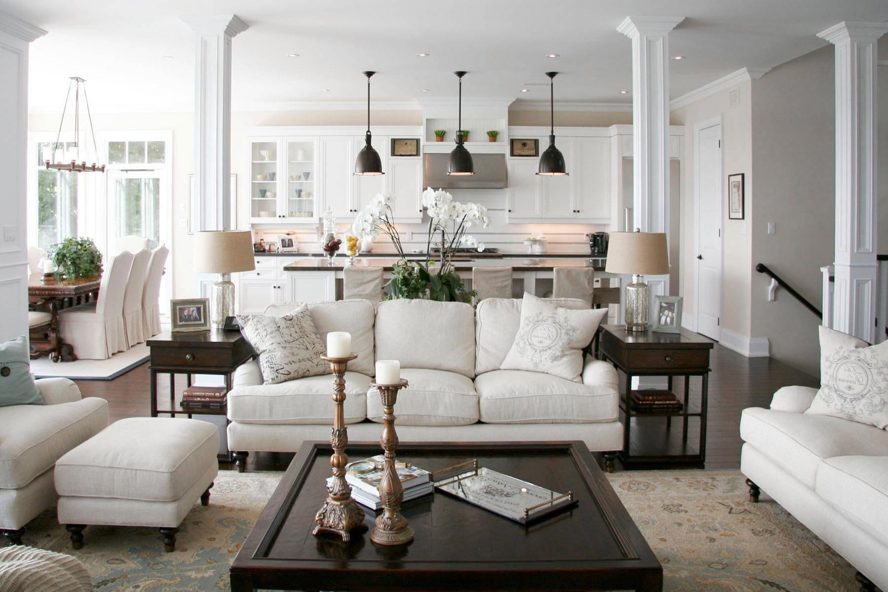 White traditional interior with black wooden furniture accents