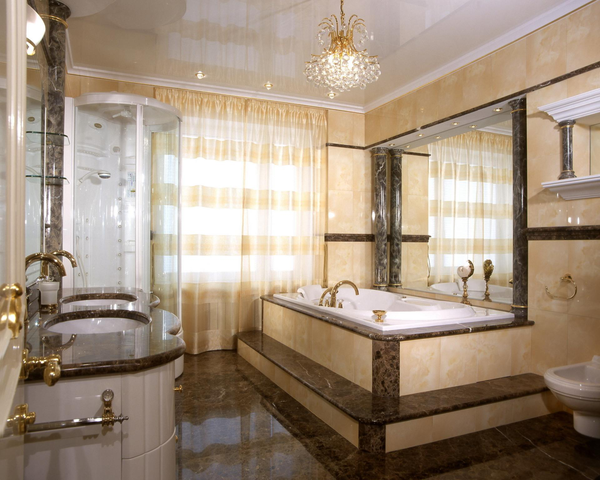 Gilded wall finishing and dark brown accents for traditional styled bathroom