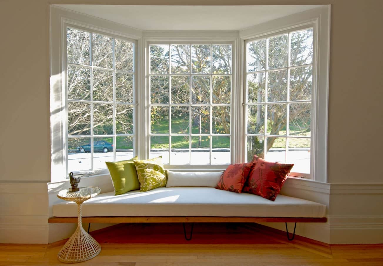 Expert Tips On Taking The Pain Out Of Window Cleaning. Big sash bay window in typical American style house with the sleeper at the windowsill