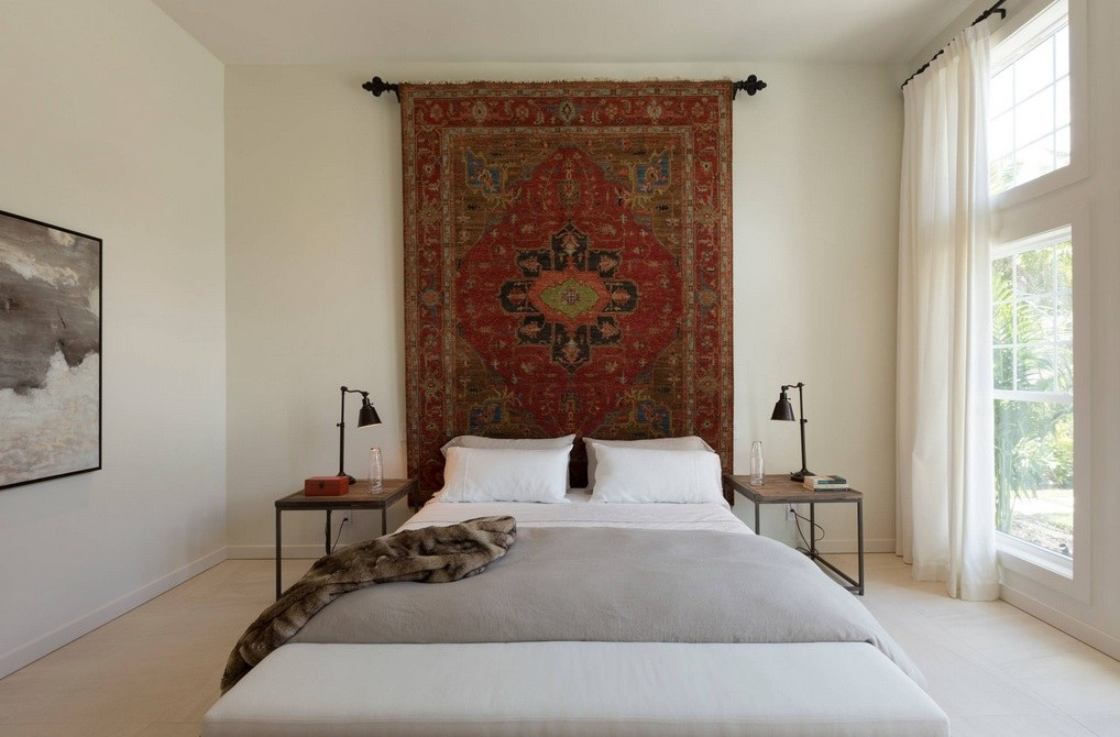 Red handcrafted Persian rug in the minimalistic bedroom