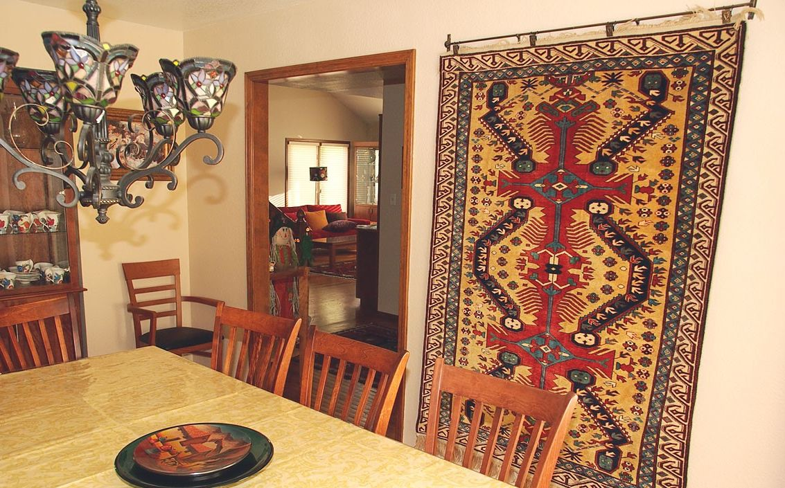 Nice Mediterranean design in the living room with emboidered carpet on the wall