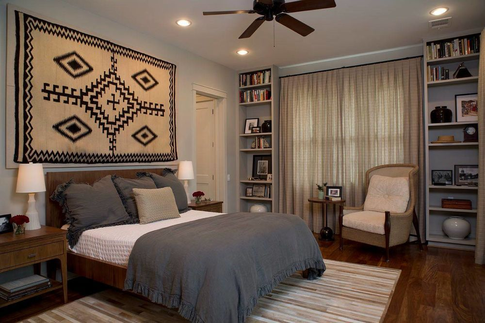 Contemporary designed bedroom with carpet at the headboard wall