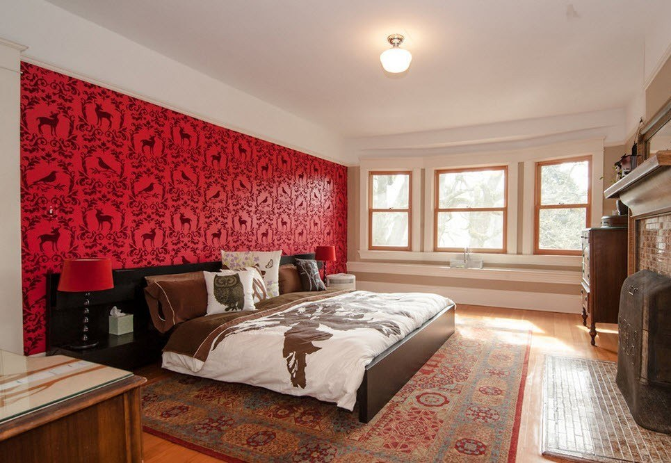 Great red patterned wall-length carpet in the casual designed room
