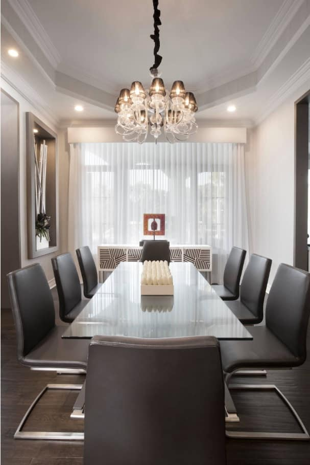 Designing Your Interior for Maximum Space Efficiency. Dining room with dark leather chairs