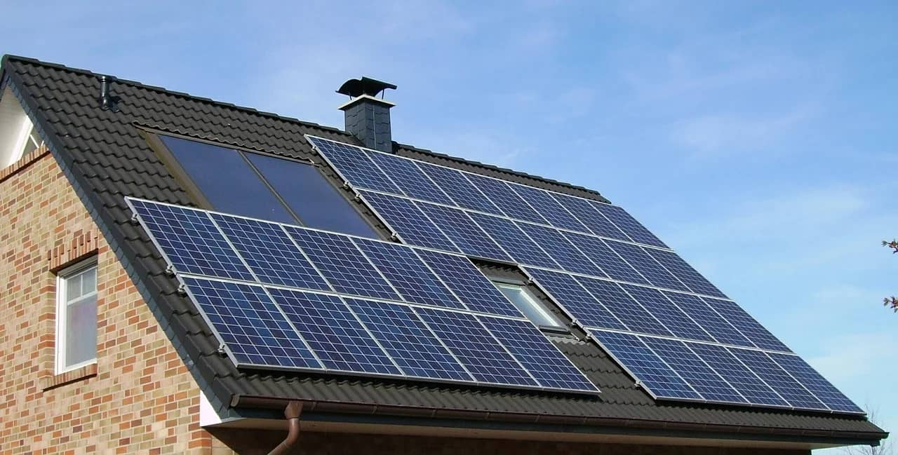 Why Going Green Can Help Sell Homes Faster. Roof with bunch of installed solar panels