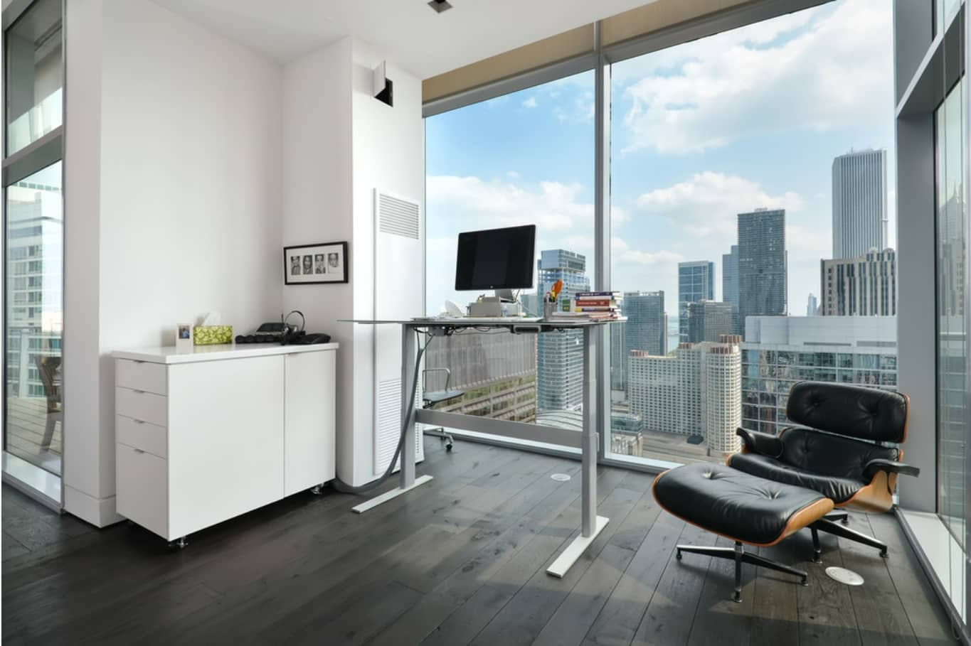 Adjustable Desk to Make Your Home Office more Universal. Modern apartment with white walls and panoramic window