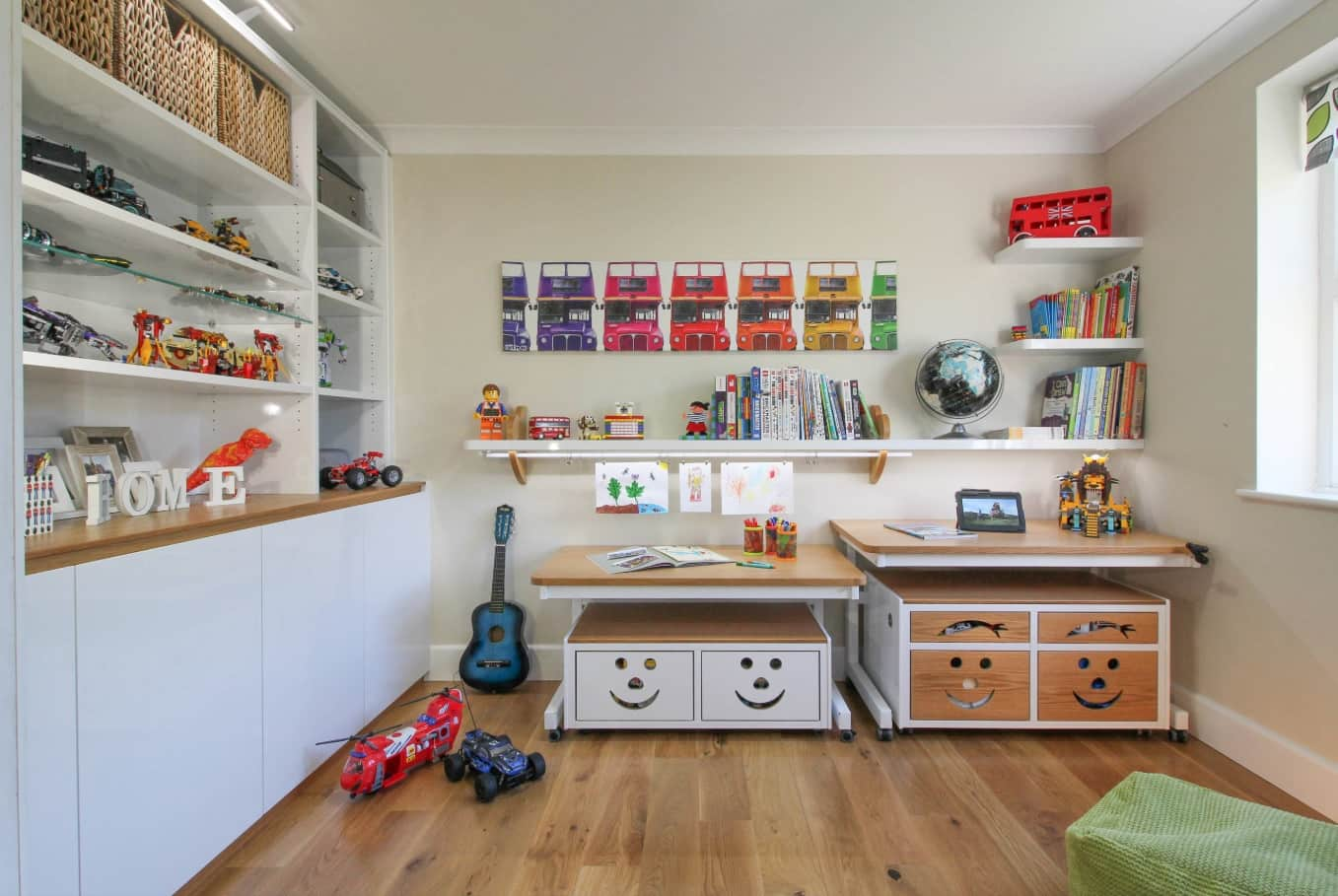 Unusual children's room with a great set of toys, educational furniture and adjustable desks